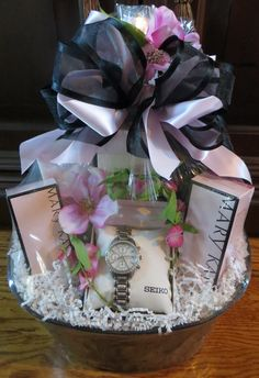 The Timewise Gift Basket, features Mary Kay products, and a Seiko watch.