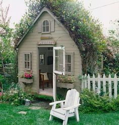 Darling little house.love the window boxes! This is not really a garden shed but rather a garden cottage. Even has a white picket fence! So quaint and cute. I continue to have hopes for my own garden shed.