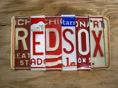 upcycled recycled license plate art sign - site has a good variety of teams, sayings, etc., and will take special orders