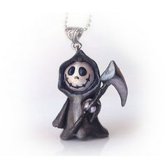 Cute Grim Reaper Polymer Clay Pendant/This little grim reaper pendant makes alternative style cute. He measures approximately 4cm (1 3/4'') top to bottom and is hand sculpted from polymer clay, painted with acrylics and coated with protective resin. By default the pendant comes on a 1mm thick silver ball chain approximately 50cm (20'') + 5cm (2'') adjustible link chain extendor. Rarely I may use something else like a small link chain or a cord, depending on what I have available.