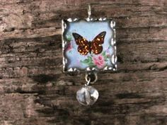 Butterfly with Orange Glitter 1 Inch Glass by MablesGranddaughter, $15.00