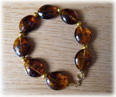 Silvia Jewellery of Style: Bracciale di perle grandi ovali marrone trasparent...