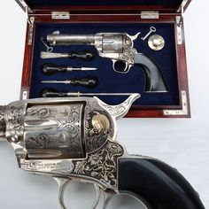 """""""Punkin"""" Colt Single Action Army - This .45 Colt, circa 1973, includes deep relief engraving by Colt Master Engraver Leonard Francolini. The engraving features sunflowers, and a pumpkin, all in the shades of silver and gold, along with four lady bugs raised in gold on the backstrap and a silver butt cap on one piece ebony grips. This sweet Colt was reportedly commissioned by Horace Greeley VI for his wife, whose nickname was """"Punkin."""""""