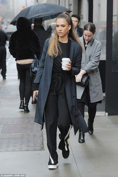Manhattan chic: Jessica Alba was spotted out and about in New York City on Tuesday wearing a stylish pewter grey overcoat that fell to her knees