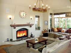 celebrity houses and real estate - Emily (Murtha) Campbell - celebrity houses and real estate Love this fireplace.and you would never guess it was Billie Jo Armstrong's house! Adobe Fireplace, Stucco Fireplace, Simple Fireplace, Fireplace Seating, Fireplace Cover, Fireplace Remodel, Fireplace Design, Fireplace Candles, Fireplace Kitchen