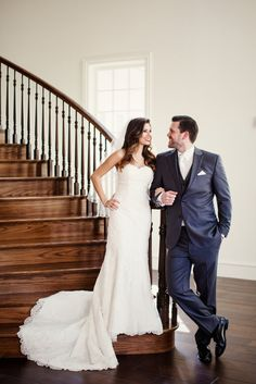 Bridal Pictures on Stairs | The Milestone Aubrey | Stella York Gown | Vera Wang Black Tuxedo [grey] | James Casey and Natalie Gore