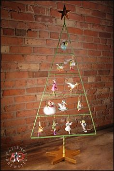"""PATIENCE BREWSTER 2012  12 DAYS MINI DISPLAY TREE    Dimensions: 38"""" x 17""""  Primary Material: Metal    Painted entirely by hand! Each piece is an individual work of art!    Your Price: $67.00"""