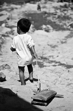 Kid playing, via Flickr.