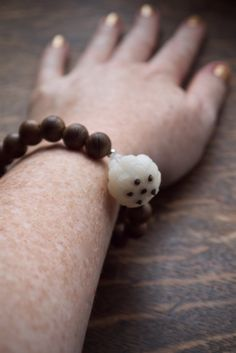 Buddhist jewellery - white lotus wrist mala in wood or pearl with hand carved bohdi lotus by Pillow Book Jewellery, soulful design. Handmade Jewelry, Handmade Items, Book Jewelry, White Lotus, Wood Bracelet, Spiritual Jewelry, Tribal Jewelry, Hand Carved, February 2016
