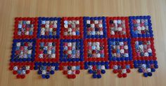 finally got back to my patriotic yo yo quilt and made a bit of ...