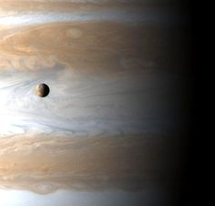 Io, a moon of Jupiter, floating above the gas giant.