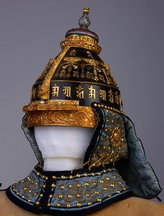 """Yongzheng period (Qing Dynasty) Ceremonial helmet at the Forbidden City Palace Museum, Beijing, currently on tour at the Royal Ontario Museum, Toronto - """"The imposing helmet is made of black lacquered leather. It is adorned with gold, coloured beads, and magical formulae in Sanskrit and believed to have protective properties."""""""