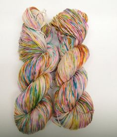 This careless sprinkling of happy - go - lucky color just makes me so happy!  It's warmth and cheerfulness takes my mind past winter directly to spring!  Jelly beans - anyone?  Simple Sock Superwash Merino & Nylon  Birthday by HauteKnitYarn