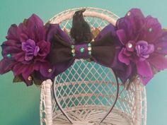 Whats a heroine without her villain? These Maleficent ears come with a wicked green sparkle and a removable raven crony to do your bidding!  Each pair of ears is unique and made with the materials I have on-hand at the time, so no two will ever be quite the same. The ear pieces themselves are made of fabric-covered polystyrene foam to keep the ears sturdy and standing straight all day long. Although these ears wont flop around as much as fabric ears, they should not be handled roughly…