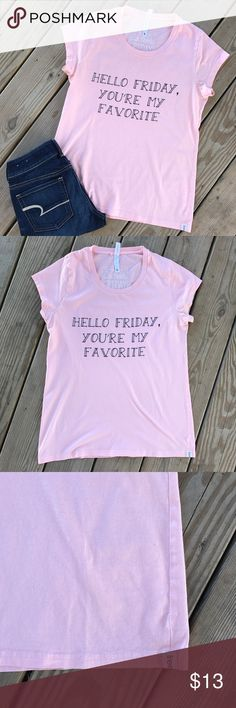 """Hello Friday! Short Sleeve Pink Graphic T-Shirt L The day we all look forward to... Friday! Such a cute fun T-Shirt that gets the weekend started! Worn 3 times. No stains or holes, but there is a tiny flaw along the neckline. Please see pictures. Flaw is hardly noticeable at all! Armpit to armpit is approx 17.5"""" and from top of shoulder to hem is approx 25.75"""". A cute T-Shirt for running warrants in or chilling in yoga pants watching Netflix! Fair Trade Friday Freeset Tops Tees - Short…"""