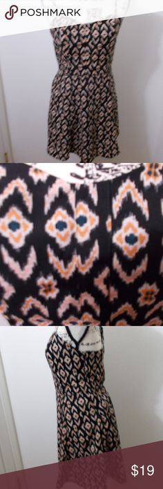 Jessica Simpson spaghetti strap sundress Jessica Simpson black and orange printed sweetheart neck spaghetti strap sundress. zip closure. 100% polyester.   Size medium - 31 chest, 28 waist, 32 length, 42 hips  See photos for details. Smoke free, pet friendly home.   Please message me with any questions. Ask if additional size detail is needed.   15% discount for 3+ item bundles. Check out my closet. Happy Poshing!  731/L Jessica Simpson Dresses