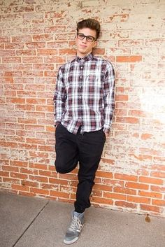 Love this simple pose for a senior guys picture. And the brick wall adds a nice texture to these senior pictures.