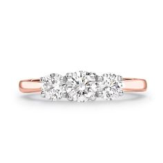 The 'Coleridge' is an elegant three stone engagement ring with a contemporary twist. Named in commemoration of the poet Samuel Taylor Coleridge, one of the founders of the Romantic movement in English literature, this best selling style is part of Heming's Trilogy Collection, designed in-house & manufactured in our London workshops. The disticntive style involves an entwined arrangement of interlocking claws holding the diamonds on a 2.5mm comfort fit band.