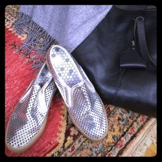 Silver DV Dolce Vita perforated Slip-ons These silver slip ons are a summer essential! They are very gently worn with a barely detectable scuff on the inner left piping. (Pic 1) The rubber sole and inner cushion provide comfort while you're out and about.  They are made out of man made leather and have small diamond cut outs....Enjoy! Dolce Vita Shoes Sneakers