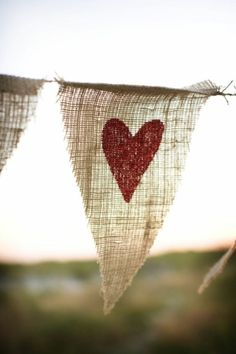 DIY Hearts amd burlap wedding banner.. This is sorta cute. Maybe around the reception area?