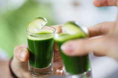 Start your day right with a spinach juice and lemon shot.