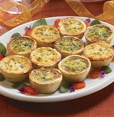 MINI QUICHE FLORENTINE. Bite-size quiches make great snacks, appetizers or part of a party platter. Pastry shells are filled with a two cheese egg mixture and spinach. 16 pieces - M & M MEAT SHOPS