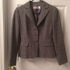 Tahari Arthur S. Levine (size 2P) Jacket Worn only a few times! For sale is a 3 button Tahari Arthur S. Levine fully lined business jacket. Has a beautiful medium/dark grey and blue plaid design. Matches many styles of pants! Very stylish to wear to work. No holes, stains, or rips. Smoke free home!i Tahari Jackets & Coats Blazers