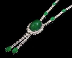 Cabochon glass emeralds surrounded by brilliant rhinestones. This is one of the finest pieces of costume jewelry you will own! The necklace has