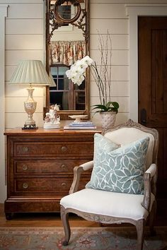 Love the mirror and chest, styled table. Beautiful chair.