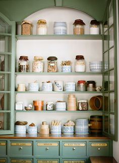 Pantry in Colonial Williamsburg Home - I love the drawers at the bottom and the optional glass doors to keep dust out...