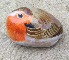 Of robin painted on stone..