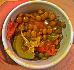 Oh just simply AH-MAZING!!! A simple stew that I made in a rice cooker, with zucchini, stewed tomatoes, lentils, onion powder, a splash of tabasco sauce and black pepper. Real comfort food. Best served over brown rice! :) What's your lunch for today?