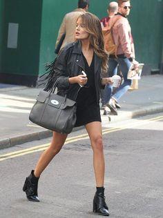 black v-neck dress with leather jacket