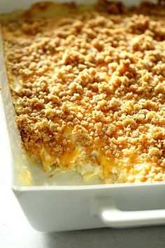 This potato casserole, or known as funeral potatoes in some areas, is total comfort food. It's a cheesy potato casserole and made from shredded potatoes, cheese, and sour cream. It's loaded with flavor and is one of the best potato casserole recipes. Cheesy Potatoes With Hashbrowns, Cheesy Hashbrown Casserole, Easy Cheesy Potatoes, Noodle Casserole, Freezer Potatoes, Crack Potatoes, Party Potatoes, Potatoes Crockpot, Cracker Barrel Hashbrown Casserole