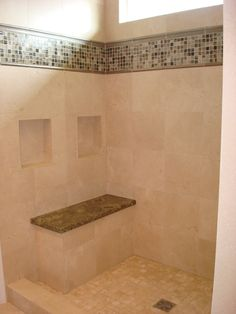 Master Bathroom Ideas: Travertine tile on walls, with dual shampoo niches; Deco band of mosaic tile, stone bench seat in shower.