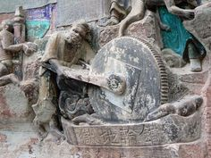 "Chinese letters below the carving says ""the hell of iron wheel"" -- Dazu Rock Carvings. China"