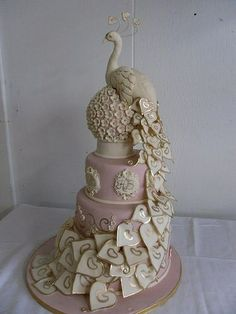 This wld be gorgeous in bright colors with gold.....GORG.....peacock wedding cake by aida