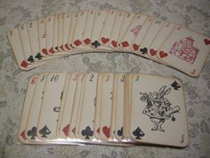 Alice in Wonderland Playing Cards - Full Size 52 Card Deck with sleeves - red queen, white rabbit, mad hatter, custom deck. $49.99, via Etsy.
