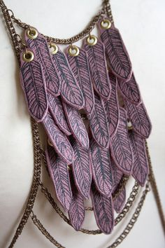 mauve leather feather amulet harness body chain necklace by paganpoetryshop, via Etsy.