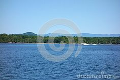 Photo about A speed boat skips across the top of the waters of lake champlain on a clear summer day crossing from Vermont to New York State. Image of boat, summer, state - 73566069 Lake Champlain, Speed Boats, Vermont, Summer Days, Ships, New York, Stock Photos, Water, Top