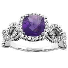 Purple Amethyst Cushion Cut Diamond Engagement Ring - One of our favorite colors on a gemstone will give her aura more radiance with this luscious Purple Amethyst Cushion Cut Diamond Engagement Ring stamped in 14k White Gold placed within a Pave setting featuring a Purple Cushion cut center stone along with White Round cut accent sides stones around the halo style mount and shank. The Purple Amethyst Cushion Cut Diamond Engagement Ring has a total gem weight of 2.04 carats with an SI1-SI2 in…
