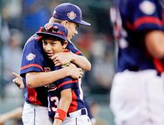 Newark, Del.'s Nathan Hardcastle and Brandon Sengphachanh celebrate after winning a game against Urbandale, Iowa, in U.S. pool play at the Little League World Series Friday in South Williamsport, Pa. (Matt Slocum/AP)