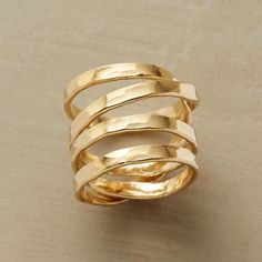 COMET'S PATH RING--Our hand-hammered 14kt gold-plated spiral ring orbits your finger with otherworldly grace. USA. Whole sizes 5 to 9.