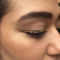 Gold eyeliner outlined in black makes for the perfect NYE look.
