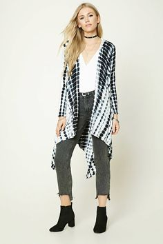 A knit, open-front longline cardigan featuring an allover abstract geo print, hood, long sleeves, and an asymmetrical drape front.