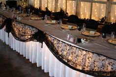 Black and White Wedding- Black chair covers with white sashes and Black table covers with white overlays give this wedding elegance. The black and white dance canopy highlight the dance floor. Maneeley's Lodge in South Windsor, CT - MJ Decorations and Home Improvement | SmugMug