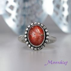 Size 7 - Oval Orange Sunstone Cabochon Ring in Sterling Silver by Moonkist Gallery. A beautiful 12 mm x 10 mm Sunstone cabochon glows with warmth from a handmade silver mounting. Visit moonkistgallery.etsy.com to see more pieces from this collection!  Repin this beautiful ring to your own inspiration board!