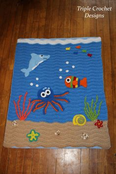 This under the sea crocheted blanket is so colorful and fun! Perfect for a childs room! The back of this blanket is light blue fleece, so its very warm and cozy. Blanket measures approximately inches Made with acrylic yarn Made in a smoke free home. Baby Afghan Crochet, Manta Crochet, Baby Afghans, Crochet Blanket Patterns, Knitting Patterns, Crochet Blankets, Crochet Crafts, Crochet Projects, Manta Animal