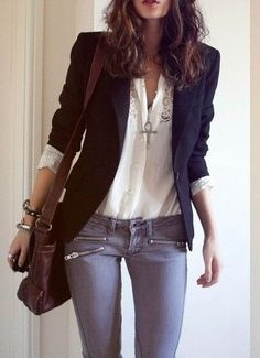 The dark blue blazer goes well with the cute lacey white blouse and the denim blue of the skinnies. Also like the way the sleeves are pulled up, revealing the cuffs of the blouse. More