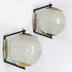 Anonymous; Brass, Lacquered Brass and Printed Glass Wall Lights by Stilnovo, 1960s.